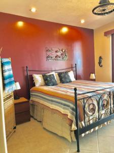A bed or beds in a room at BELLA SIRENA RESORT