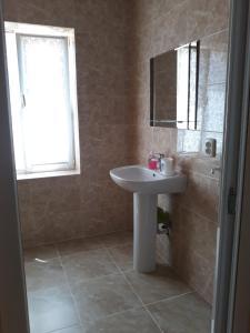 Ванная комната в Guest House Sevilya Гостевой Дом Севилья