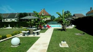 The swimming pool at or near Le Domaine des Papillons
