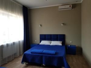 Кровать или кровати в номере Guest House Tatyana