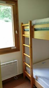 Un ou plusieurs lits superposés dans un hébergement de l'établissement Les Brasses