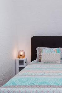 A bed or beds in a room at IGLU BY THE SEA 5 Beachfront Trinity Beach Sleep 4