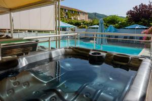 The swimming pool at or near Hotel U Ricordu & Spa