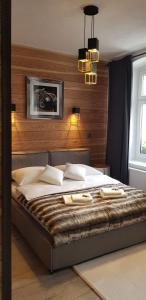 A bed or beds in a room at Zajazd Karczma Zagłoba