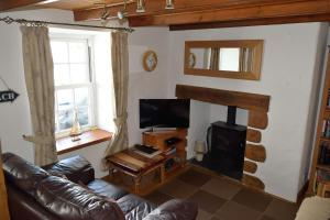 A television and/or entertainment center at Engellie Cottage