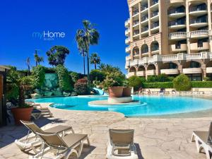 The swimming pool at or close to MyHome Riviera - Cannes Sea View Apartment Rentals