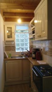 A kitchen or kitchenette at Zacharoula Rooms