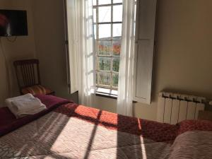 Una cama o camas en una habitación de La Morada Aparts & Suites