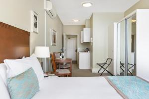 A bed or beds in a room at Quest Launceston