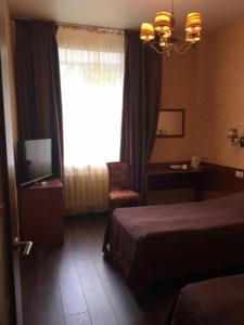 Кровать или кровати в номере Гостиница Спорт
