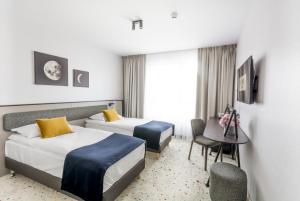 Łóżko lub łóżka w pokoju w obiekcie Antares Hotel