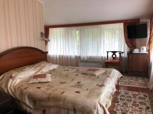 Кровать или кровати в номере Седьмое небо Отель