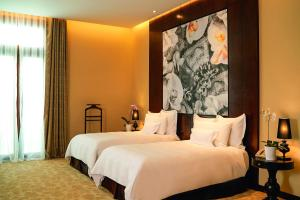 A bed or beds in a room at Country Club Lima Hotel – The Leading Hotels of the World