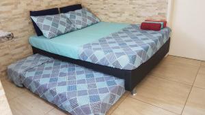 A bed or beds in a room at Loft Aconchegante em Petrópolis
