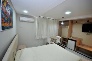 Cama ou camas em um quarto em Hotel Sabino Palace