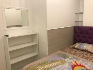 Кровать или кровати в номере Апартаменты 10 минут от моря