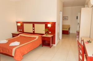 A bed or beds in a room at Tsamis Zante Hotel & Spa