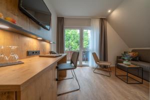 Küche/Küchenzeile in der Unterkunft Pflugwirts Hotel und Gasthaus