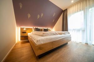 Ein Bett oder Betten in einem Zimmer der Unterkunft Pflugwirts Hotel und Gasthaus