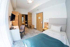 Ein Bett oder Betten in einem Zimmer der Unterkunft Hotel Limanova