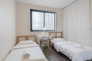 A bed or beds in a room at Nice and Clean Apartment with Free Wifi and Netflix