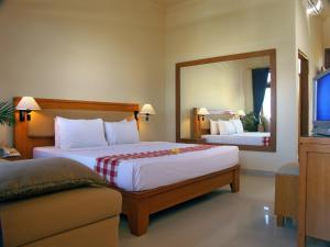 A bed or beds in a room at Febri's Hotel & Spa