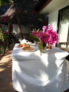 A restaurant or other place to eat at Kinazi Upepo Beach Hotel