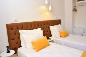 A bed or beds in a room at Hotel Sol Algarve by Kavia