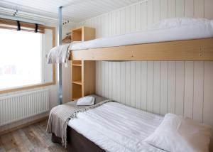 Våningssäng eller våningssängar i ett rum på Camp Ripan