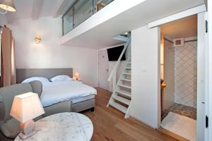 A bed or beds in a room at Casa Colloredo Free Parking