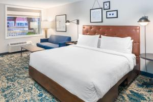 A bed or beds in a room at Four Points by Sheraton Eastham Cape Cod