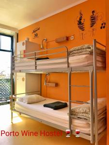 A bunk bed or bunk beds in a room at Porto Wine Hostel