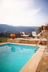 The swimming pool at or near VILLA GALATIA Personal Retreat surrounted by virgin mountains