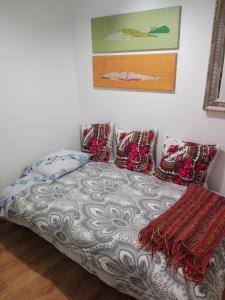 A bed or beds in a room at Era Uma Vez Apartment