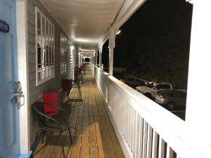 A balcony or terrace at Travelodge by Wyndham Cape Cod Area