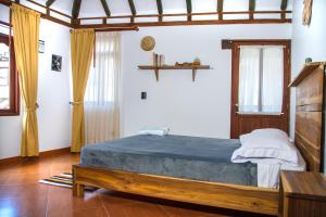 Un ou plusieurs lits dans un hébergement de l'établissement Nibiru Hostel