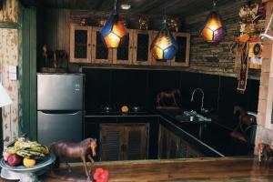 A kitchen or kitchenette at Honeymoon Green Villa