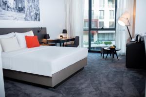 Krevet ili kreveti u jedinici u objektu CUE Podgorica