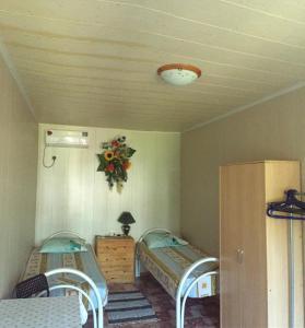 Кровать или кровати в номере Пансионат Уральский Теремок