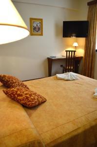 Una cama o camas en una habitación de Gran Hotel Presidente