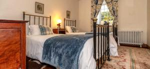 A bed or beds in a room at Mill Of Nethermill Holidays