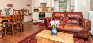 A seating area at Mill Of Nethermill Holidays