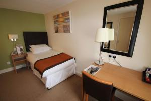 A bed or beds in a room at Lord Nelson