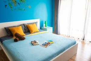 A bed or beds in a room at ZZZ Hostel @ Don Mueang Airport Bangkok