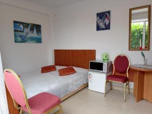 Łóżko lub łóżka w pokoju w obiekcie Villa Christina