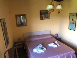 Letto o letti in una camera di Appartamento del cuore