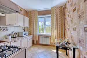 A kitchen or kitchenette at Apartment near the President's Park. Orbita-2