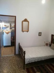 Ένα ή περισσότερα κρεβάτια σε δωμάτιο στο Manu's (Great GrandMother's) House