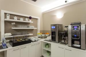 A kitchen or kitchenette at Best Quality Hotel Gran Mogol