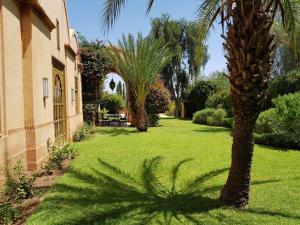 A garden outside Villa Le Golf